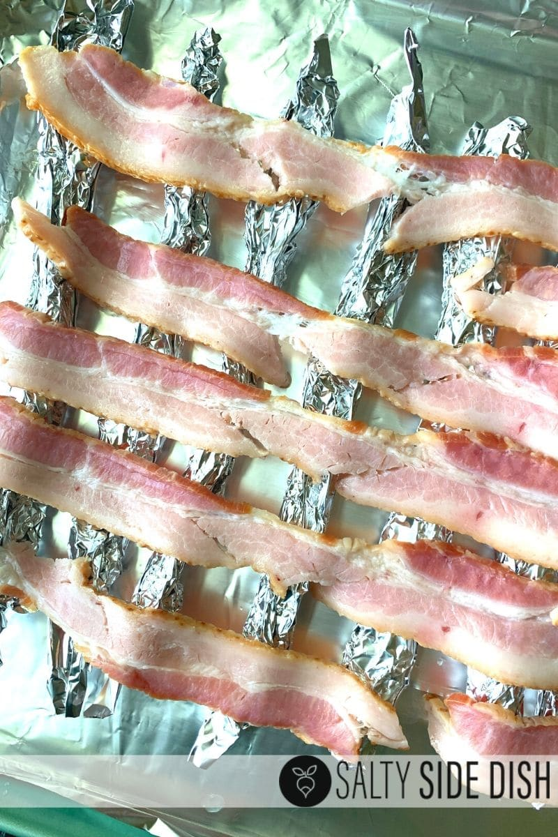 add raw bacon to your sheet pan and prep for the oven
