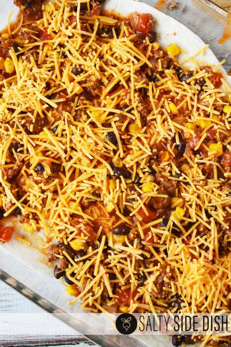 adding cheese to top layer of mexico casserole bake