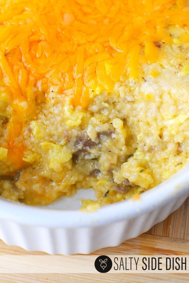 Sausage and grits casserole with cheese in a dish