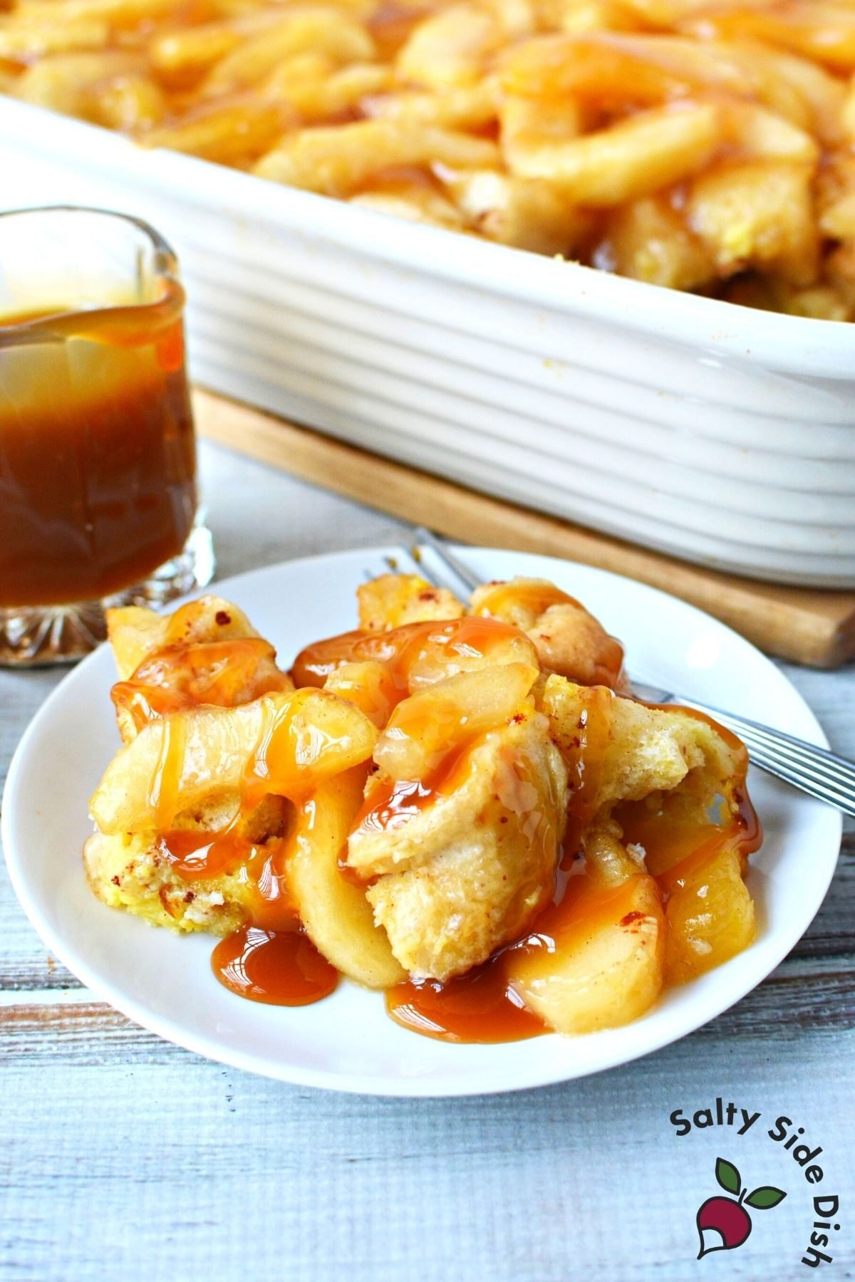 plate of apple pie breakfast bake with caramel sauce.