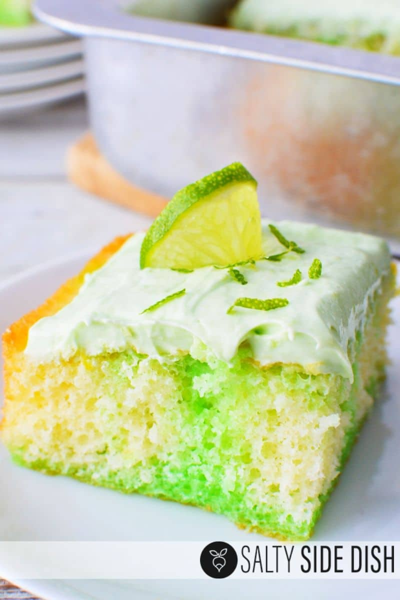 key lime poke cake with lime jello center topped with lime pieces and whipped topping