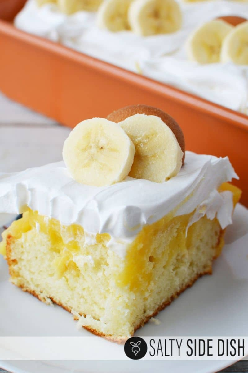 Topped layers of whipped topping and banana pudding for a rich delicious poke cake recipe