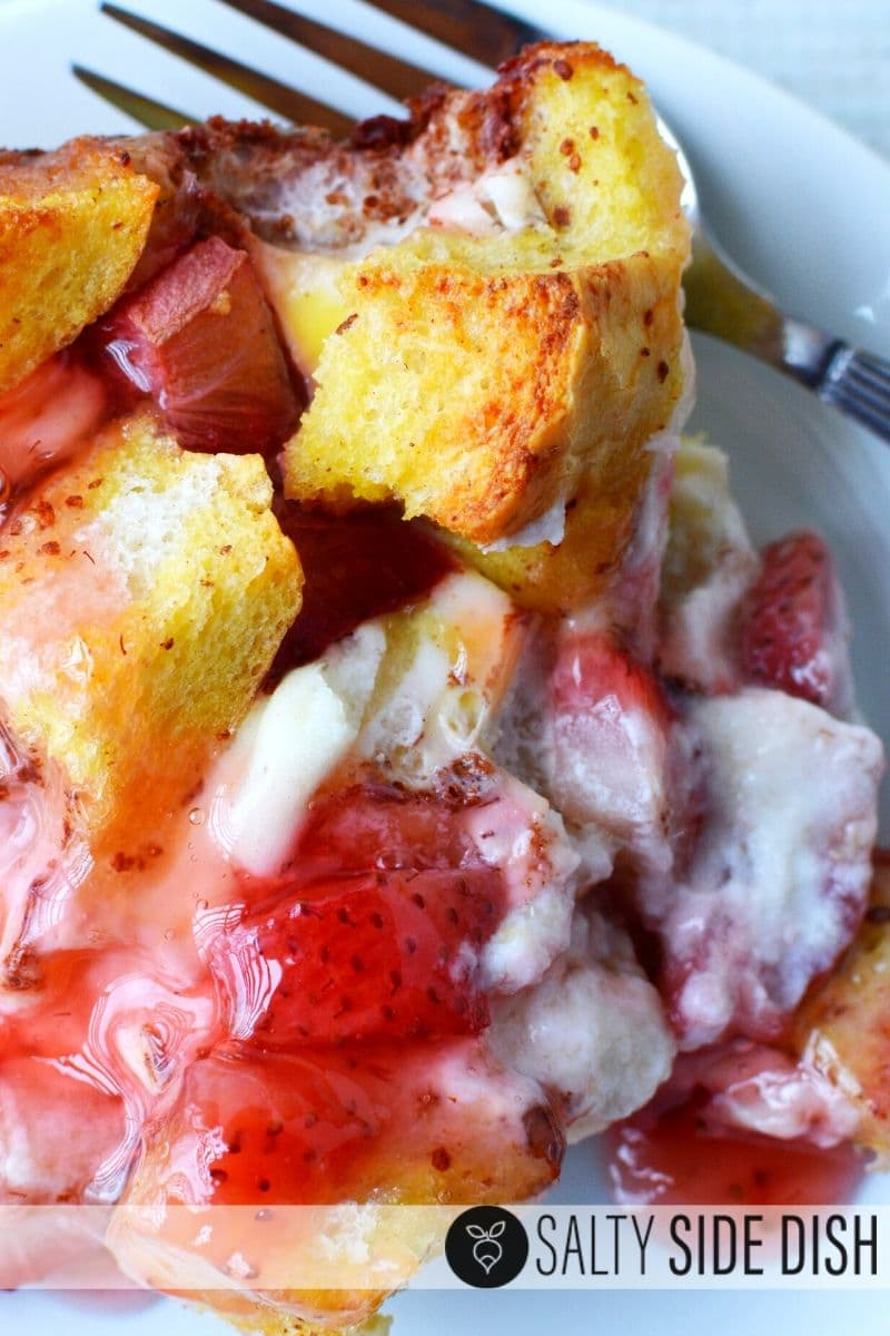 Strawberry French toast casserole with layered of cream cheese and italian bread cubes already cooked and ready to serve warm