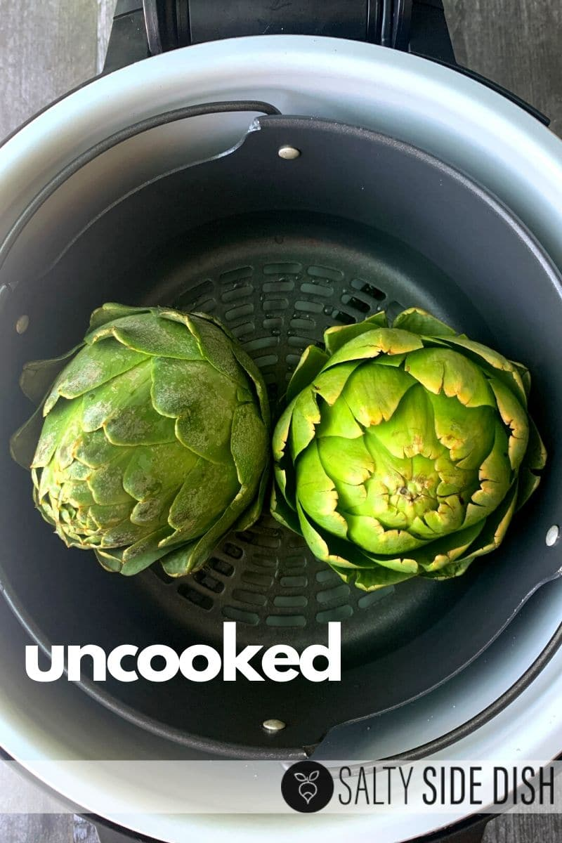 raw artichokes ready in pressure cooker basket