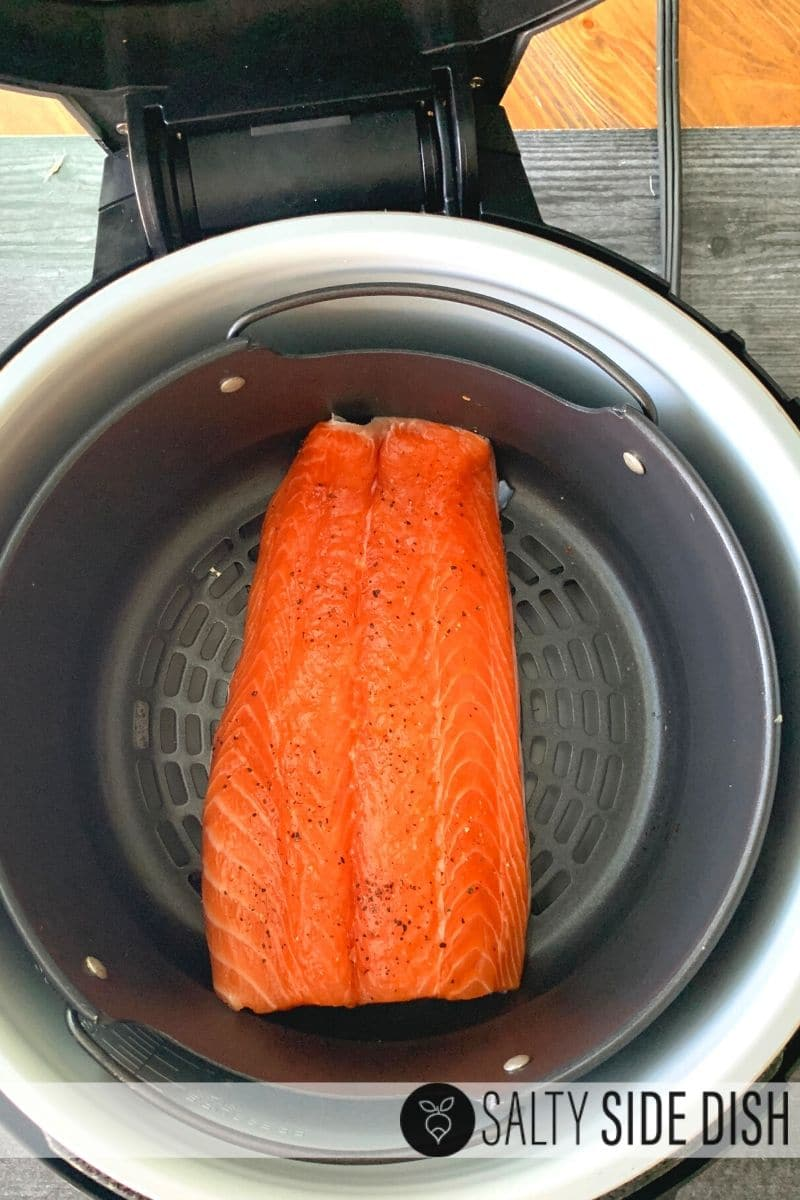 lay salmon in the air crisp basket of the air fryer