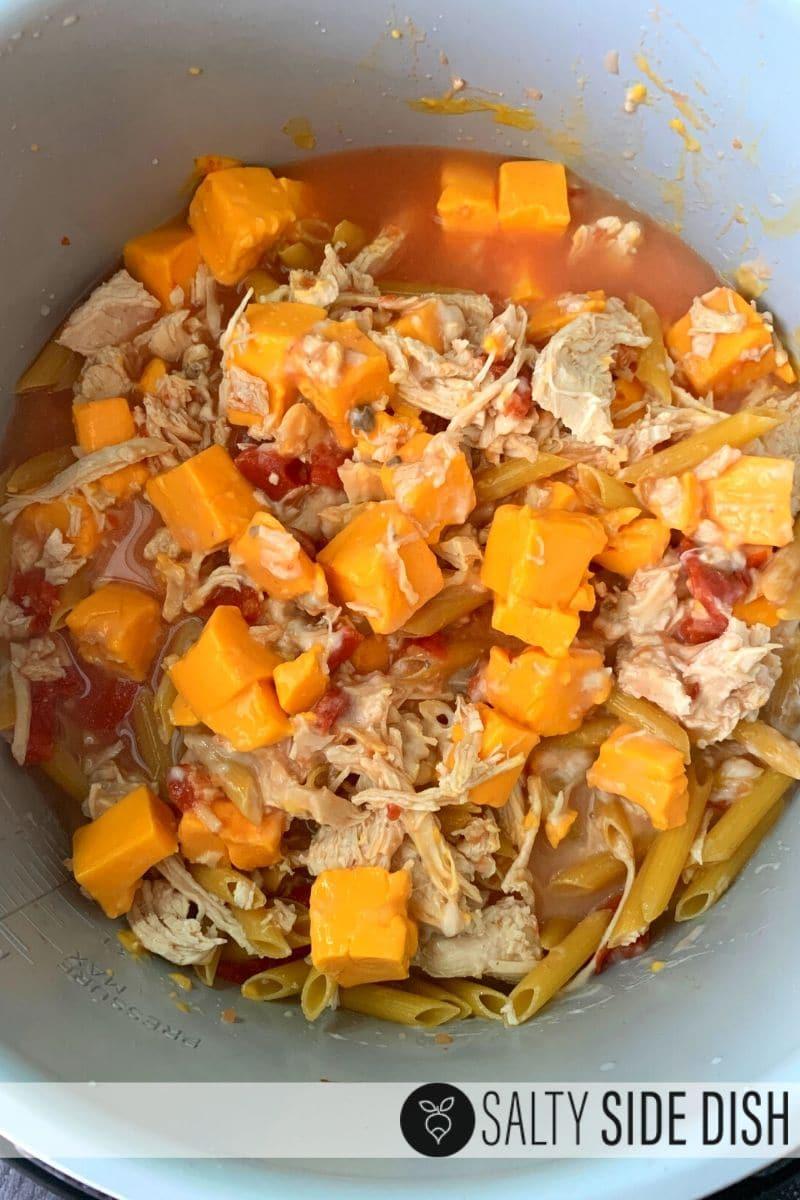 stir your pressure cooker chicken penne pasta ingredients