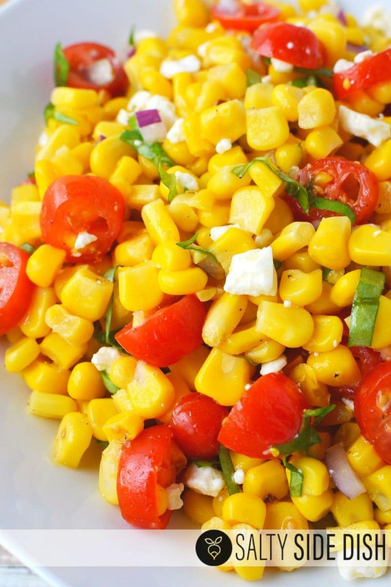 Corn and tomato salad with feta cheese an easy side salad recipe done in under 10 minutes