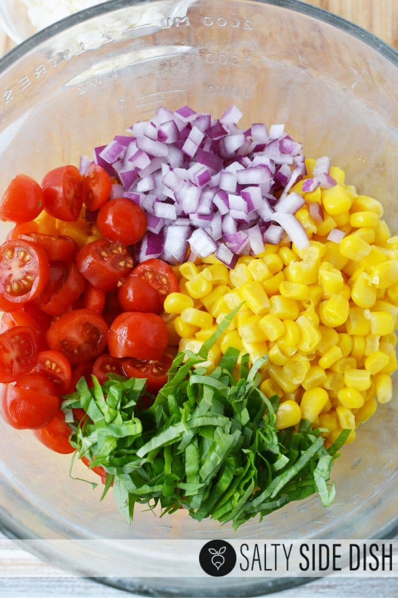 simple easy cold side salad recipe perfect for picnics with this corn and tomato salad with purple onions, fresh basil and little tomatoes