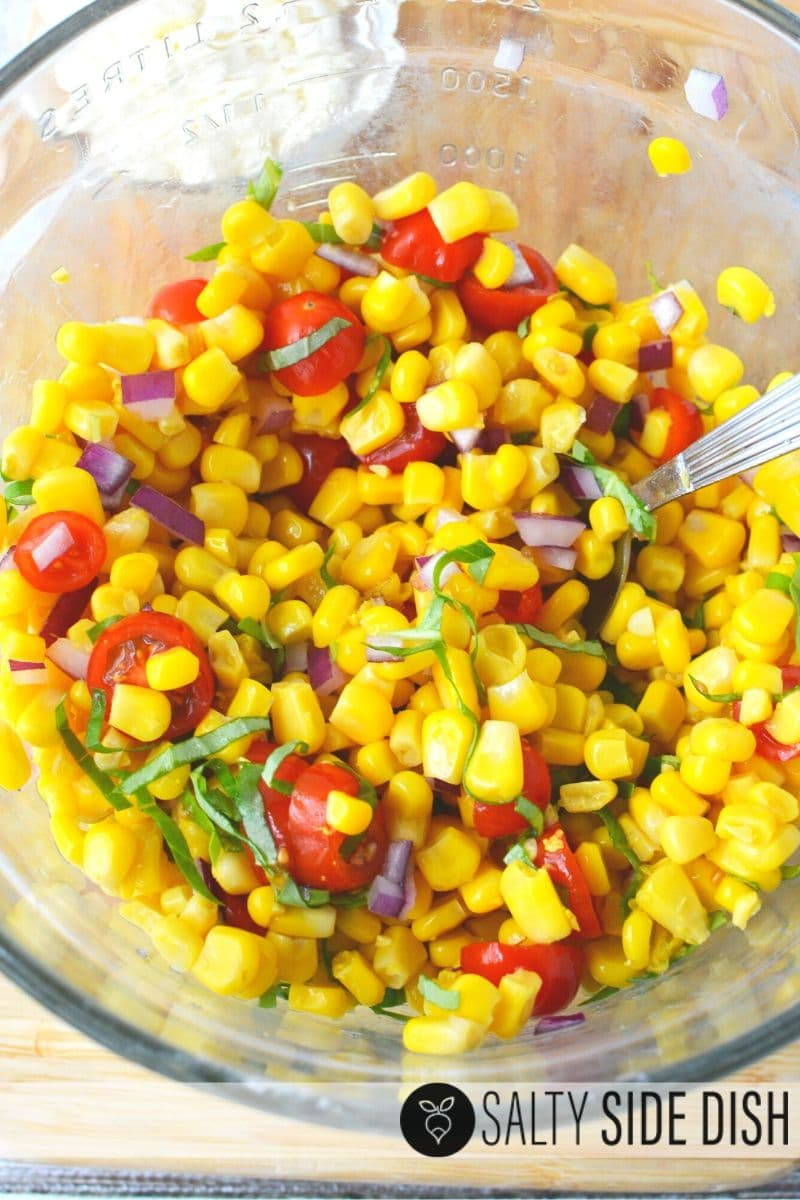 Mix up cherry tomatoes and drained corn with seasonings and herbs for the perfect cold side salad recipe