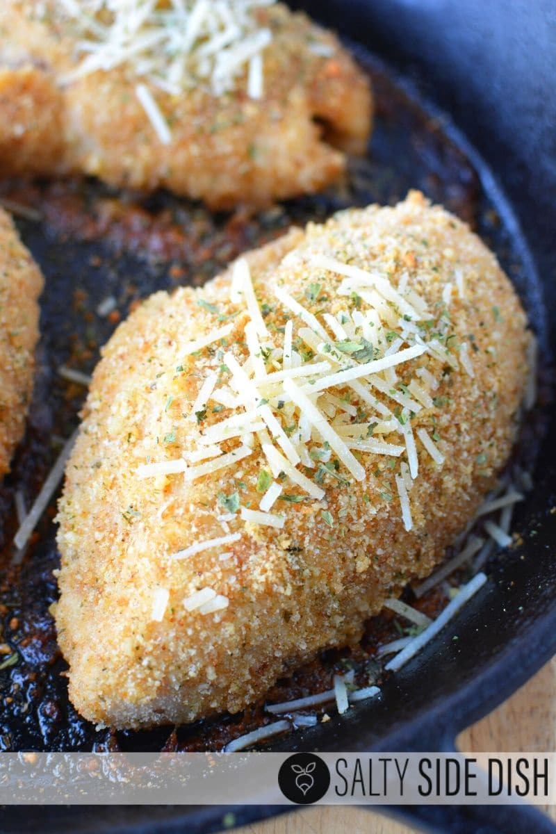 Chicken breast recipe with bread crumbs and Parmesan cheese in a cast iron pan