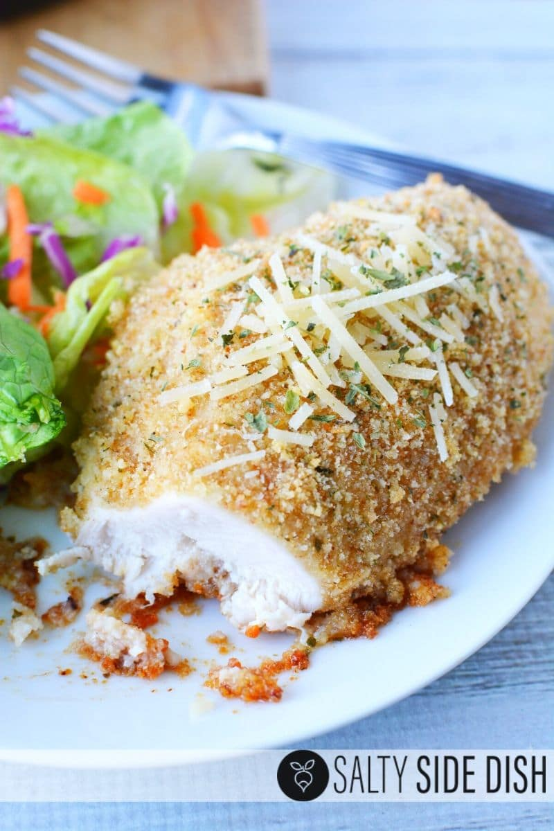 chicken dinner cut into with garlic and extra Parmesan cheese