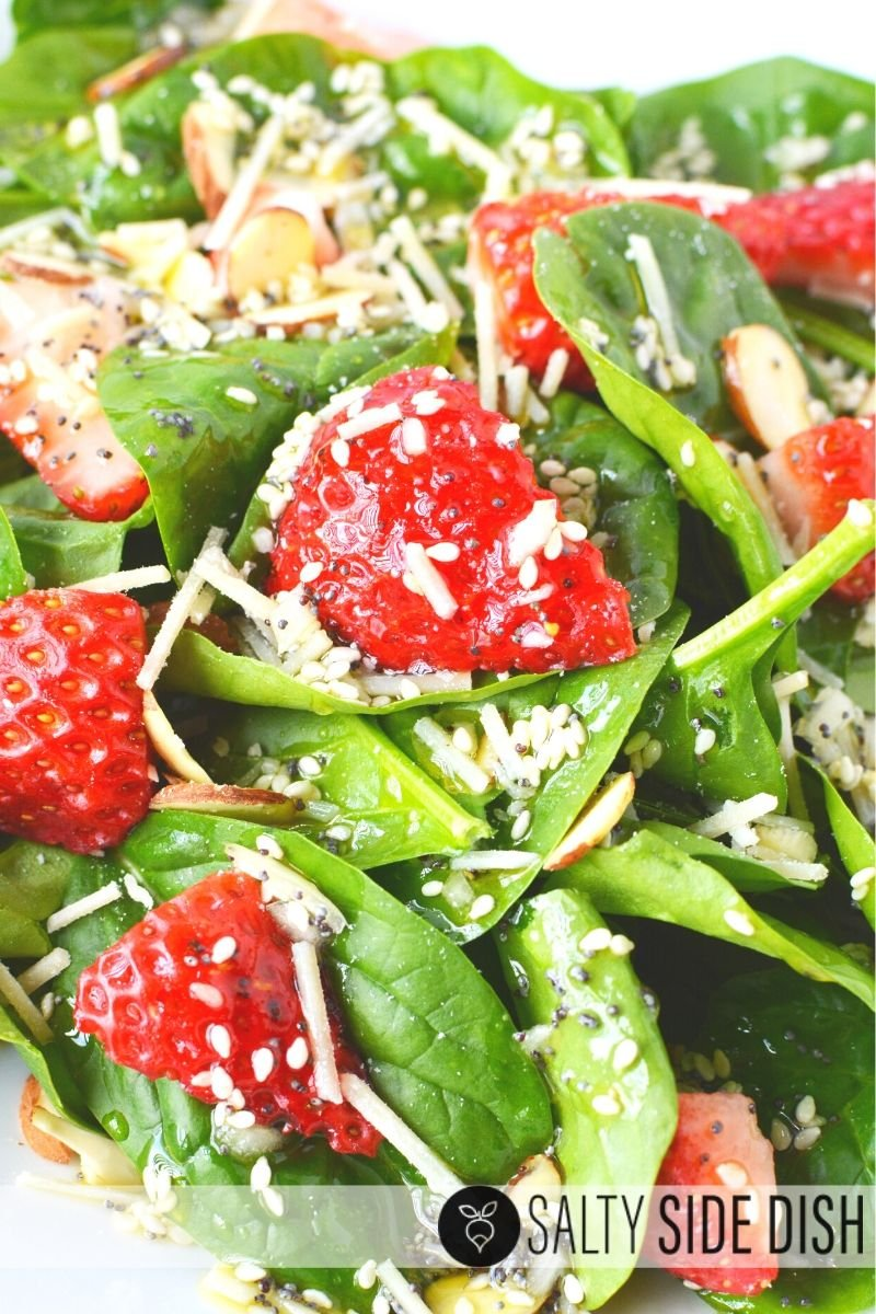 Spinach Strawberry Salad with fresh Parmesan and delicious chunky strawberries wrapped in a sweet homemade dressing recipe