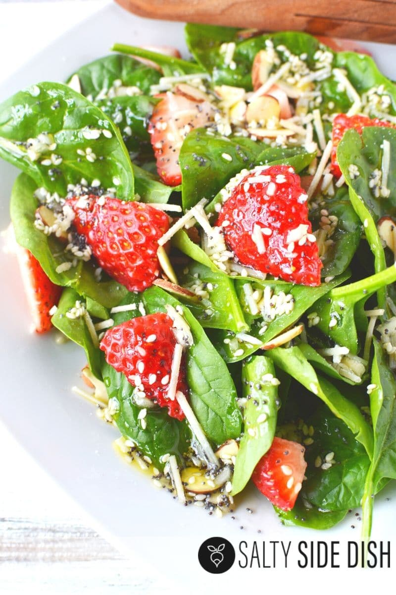 Easy 10 minute salad side dish with spinach, strawberries and homemade sweet dressing