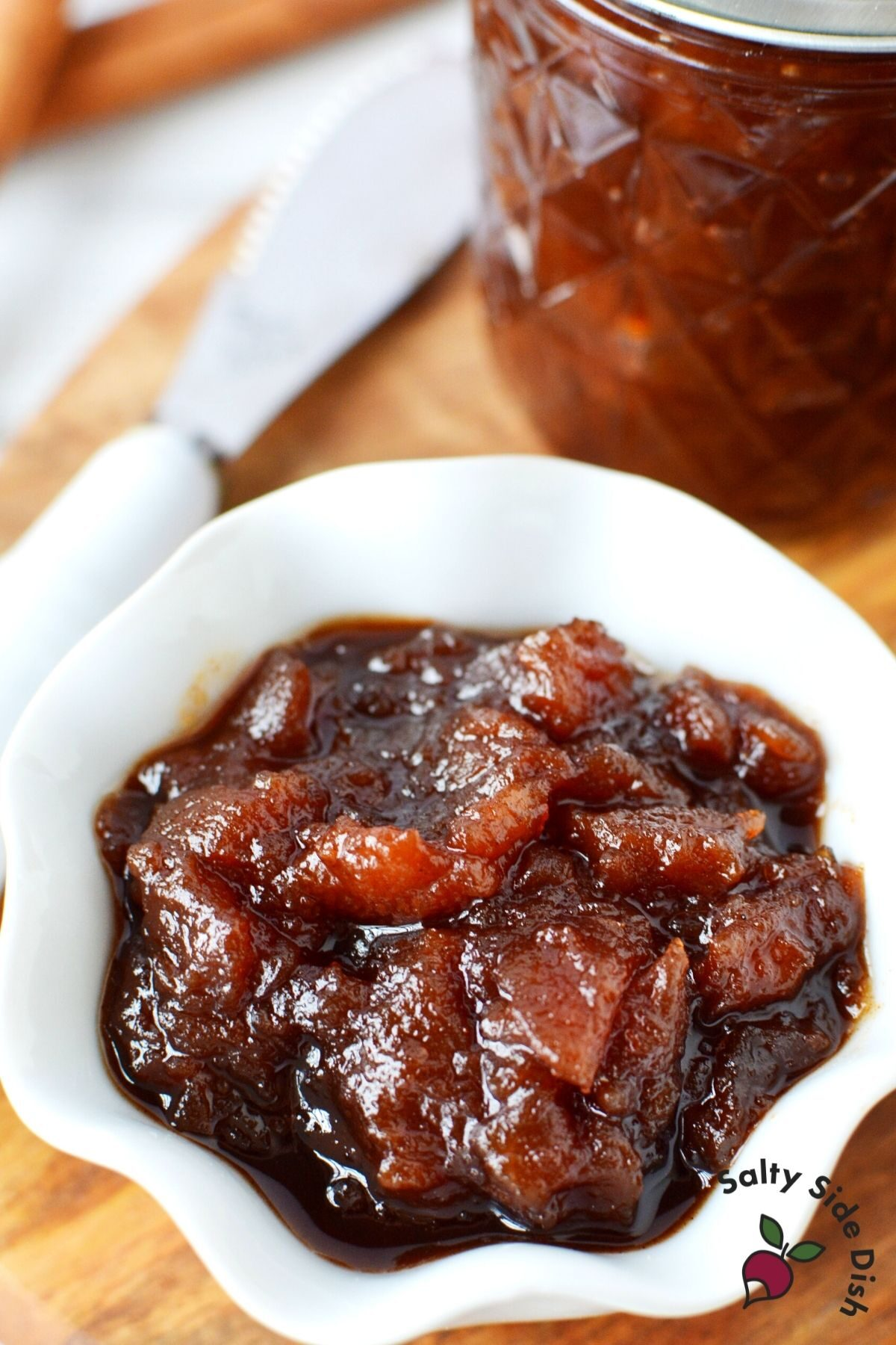 apple butter recipe with chunks of apples, sitting in a bowl ready to serve up