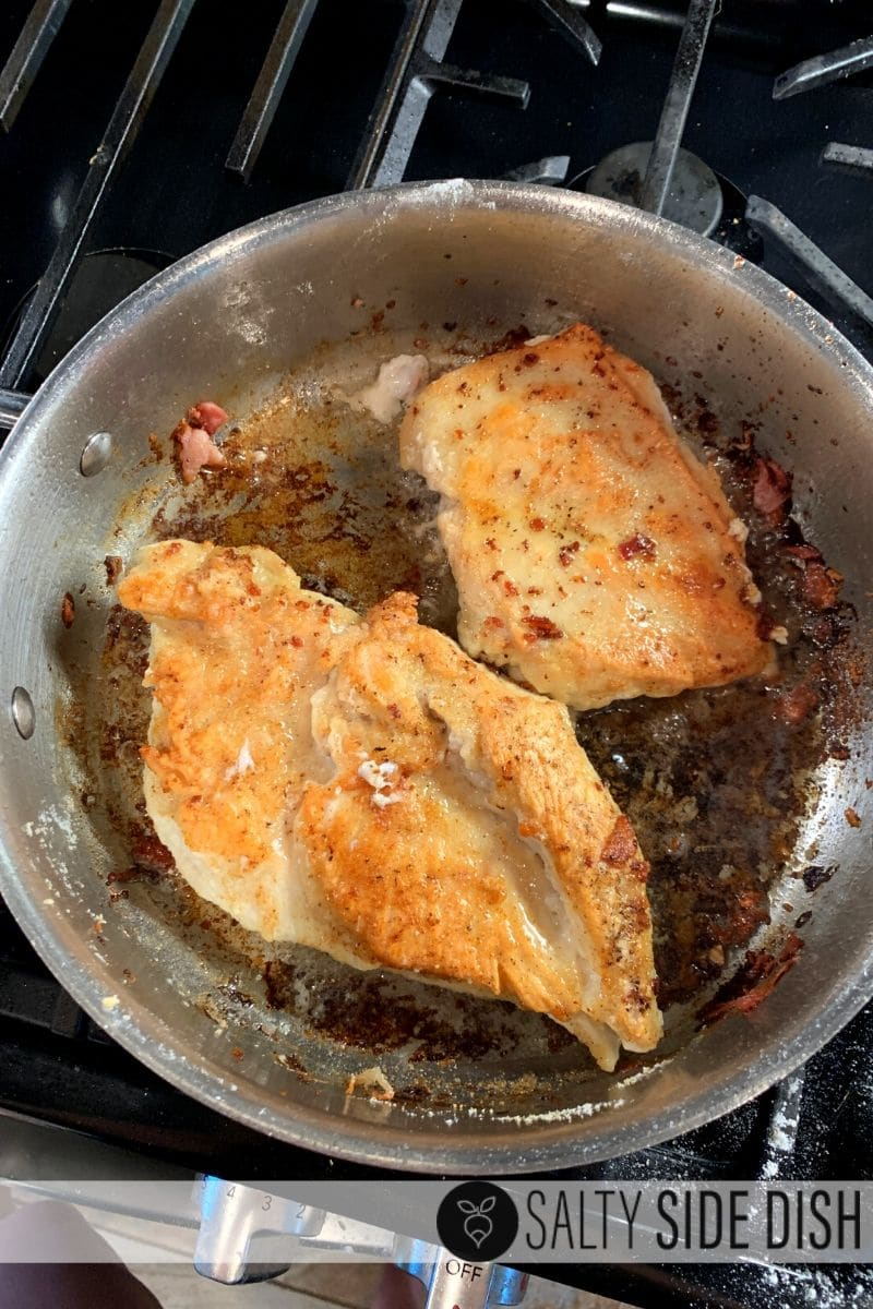 Frying up chicken breasts with bacon grease in a stove top pan