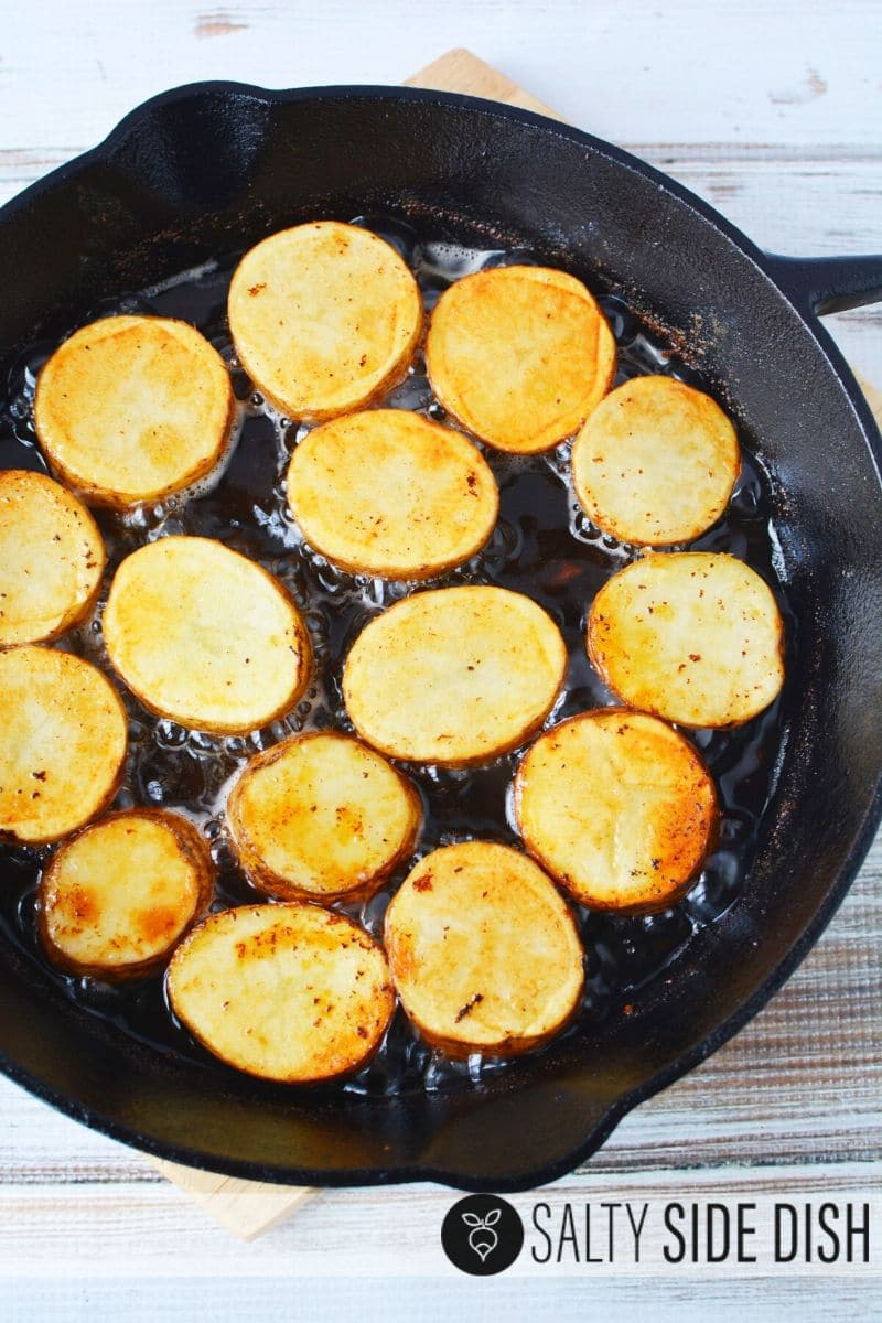 potatoes frying up in pan and ready for the oven