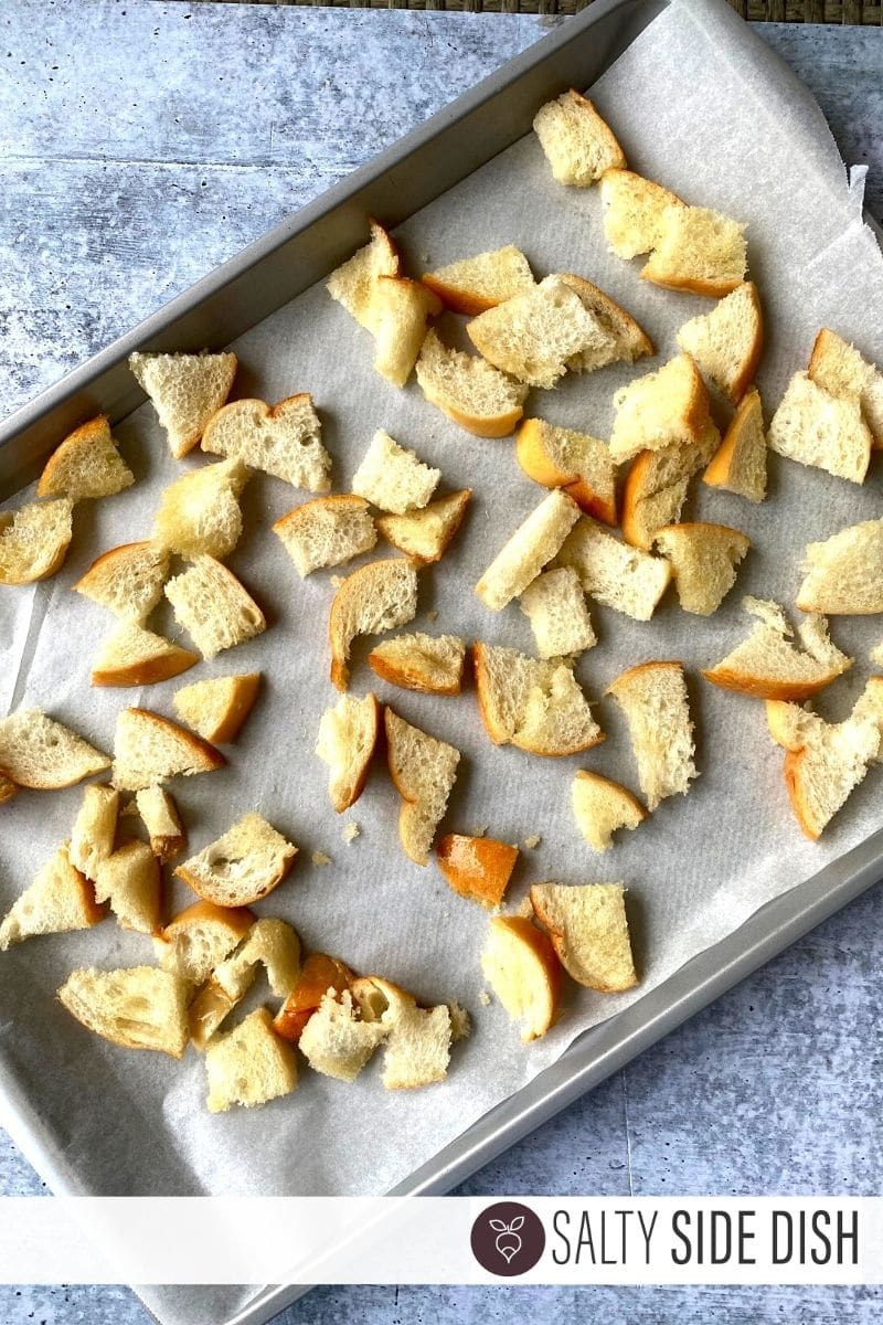 french bread torn and made up on sheet pan ready for croutons