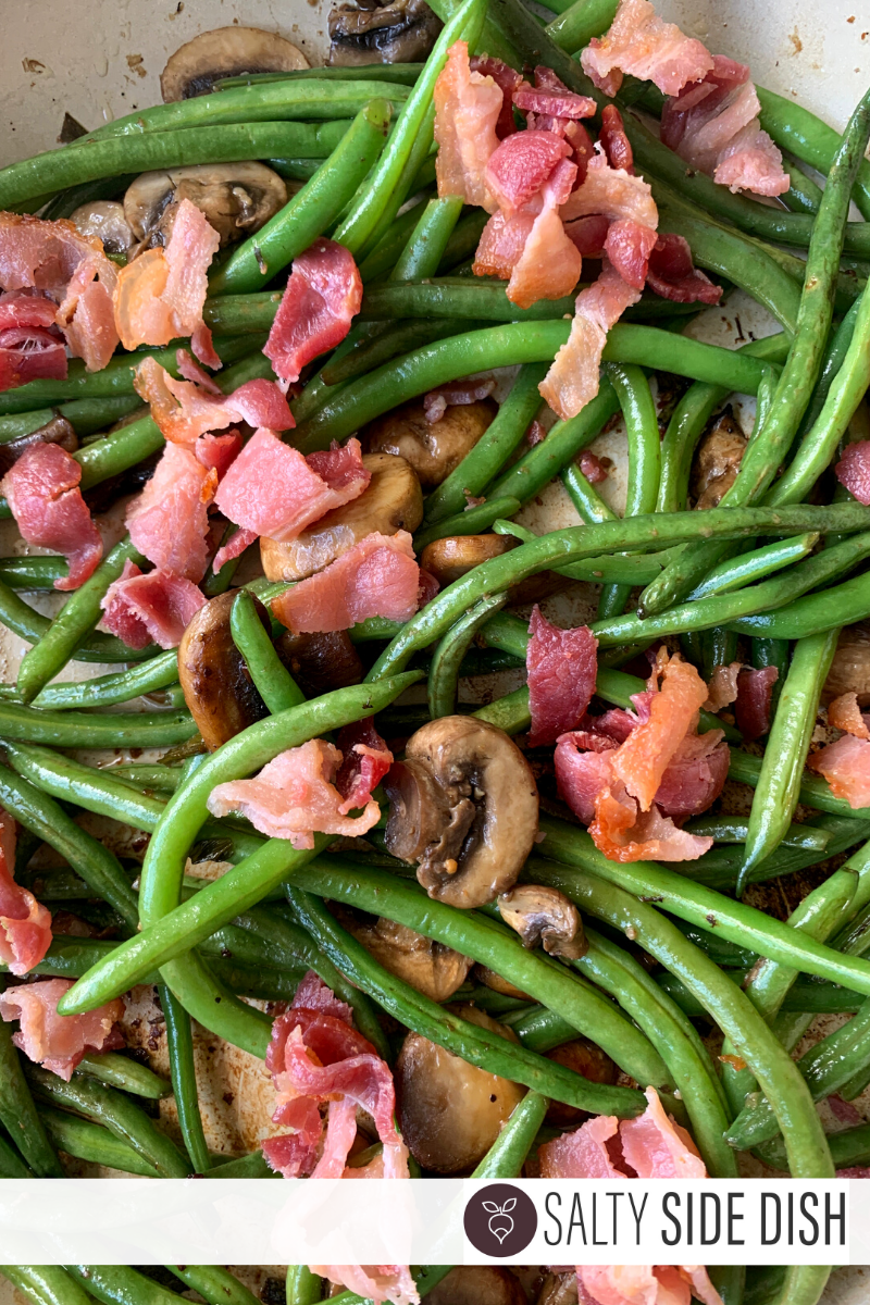 Cast Iron Fresh Green Beans, bacon and mushrooms in a pan