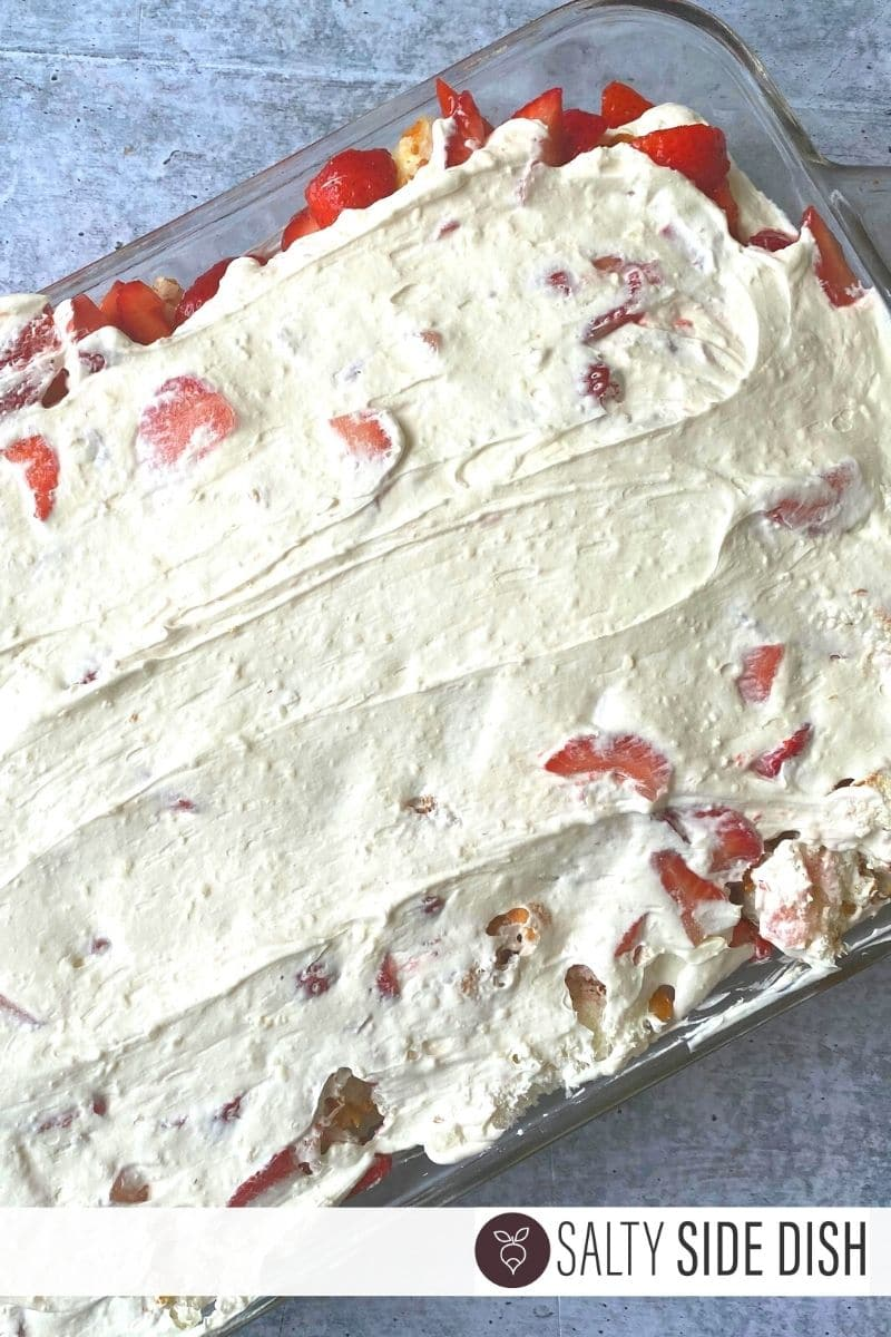 delicious and easy no bake angel food cake, strawberries and top layer of whipped cream