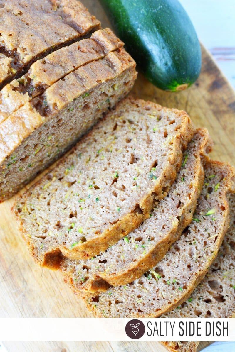 Super Moist Zucchini Bread recipe sliced on a counter