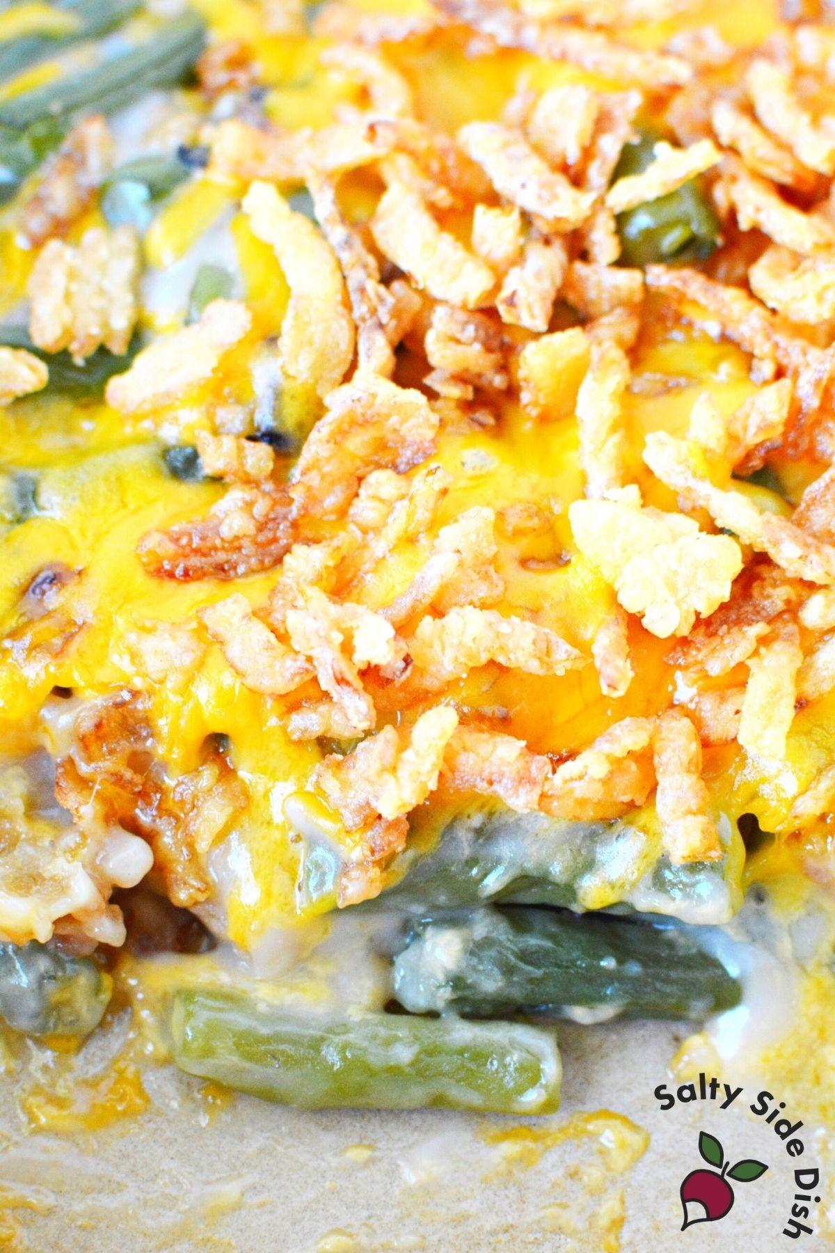 a casserole dish full of green bean casserole with fresh green beans.