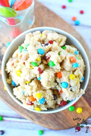 edible cookie dough in a white bowl sitting on a table