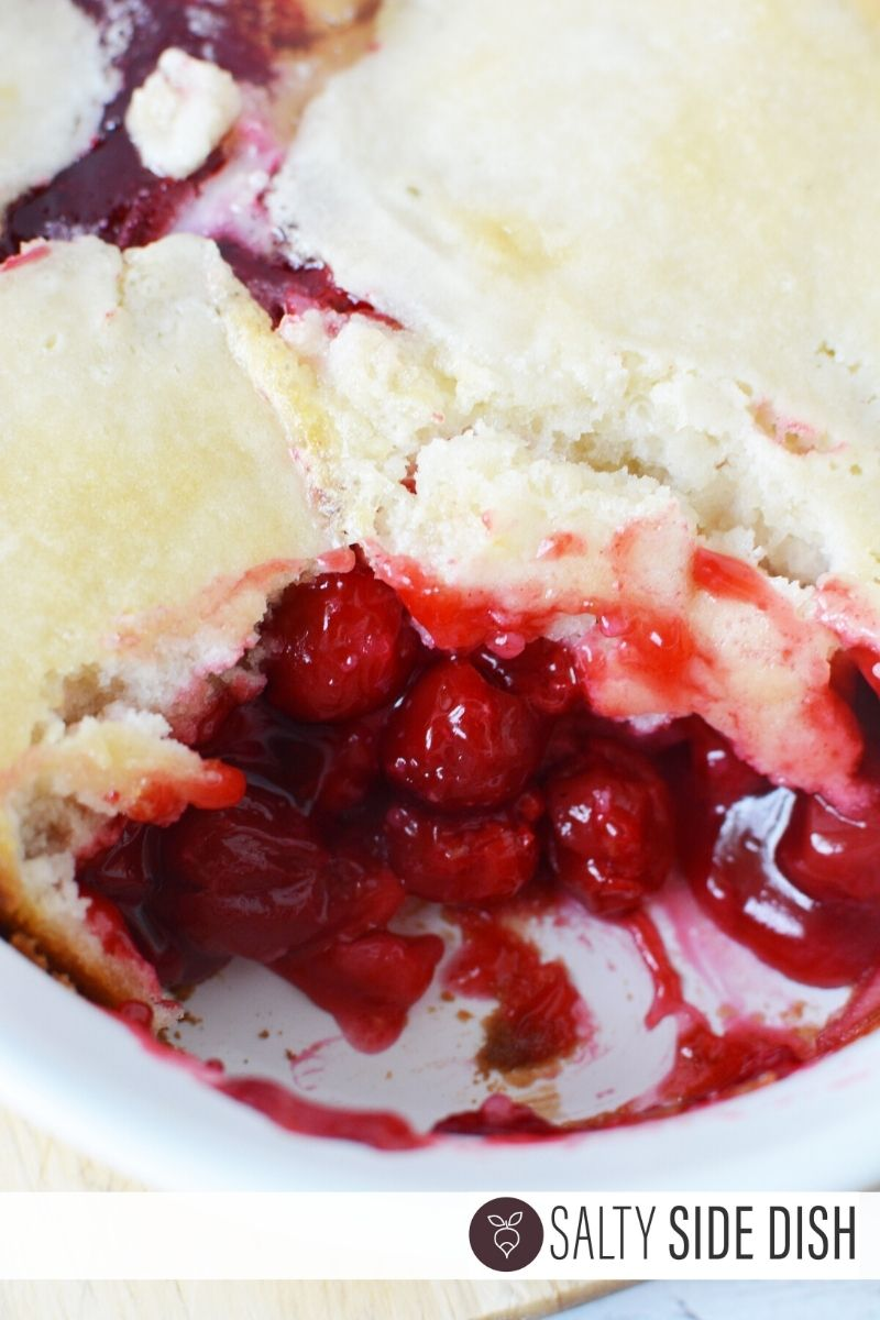 Cherry Cobbler Recipe with scoop out of the casserole dish