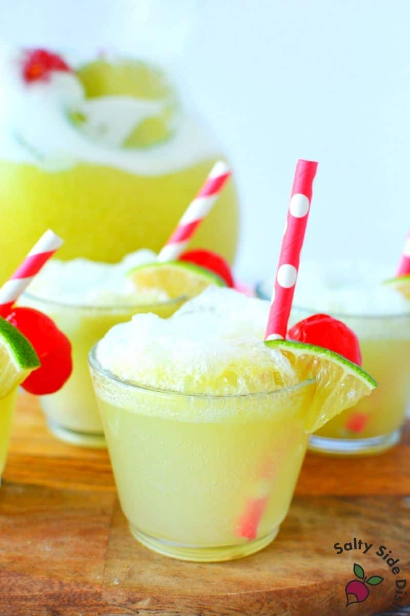 easy to serve Lime Sherbet Party punch wtih straws and little lime pieces
