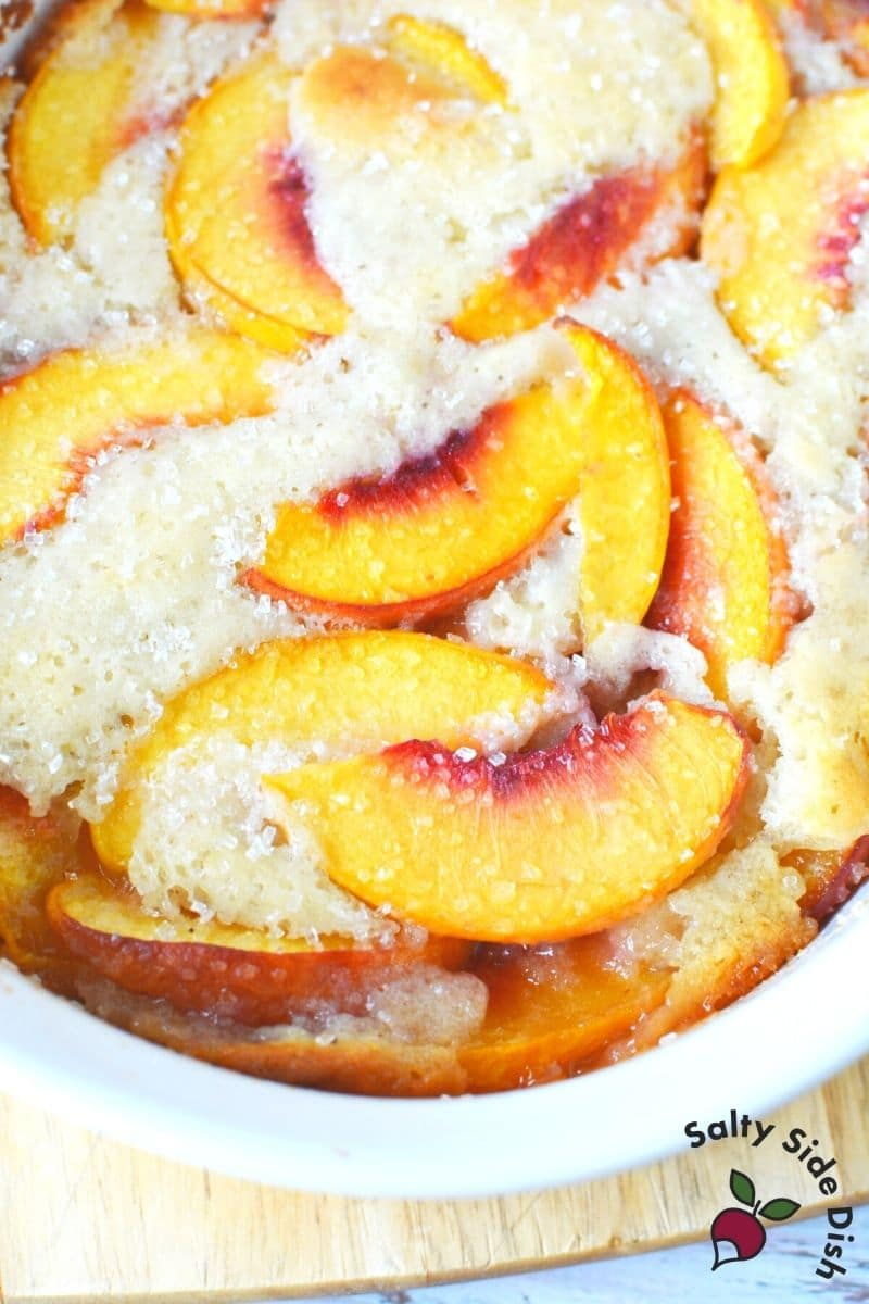 golden brown fresh peaches sugared and in a bowl ready to serve already cooked