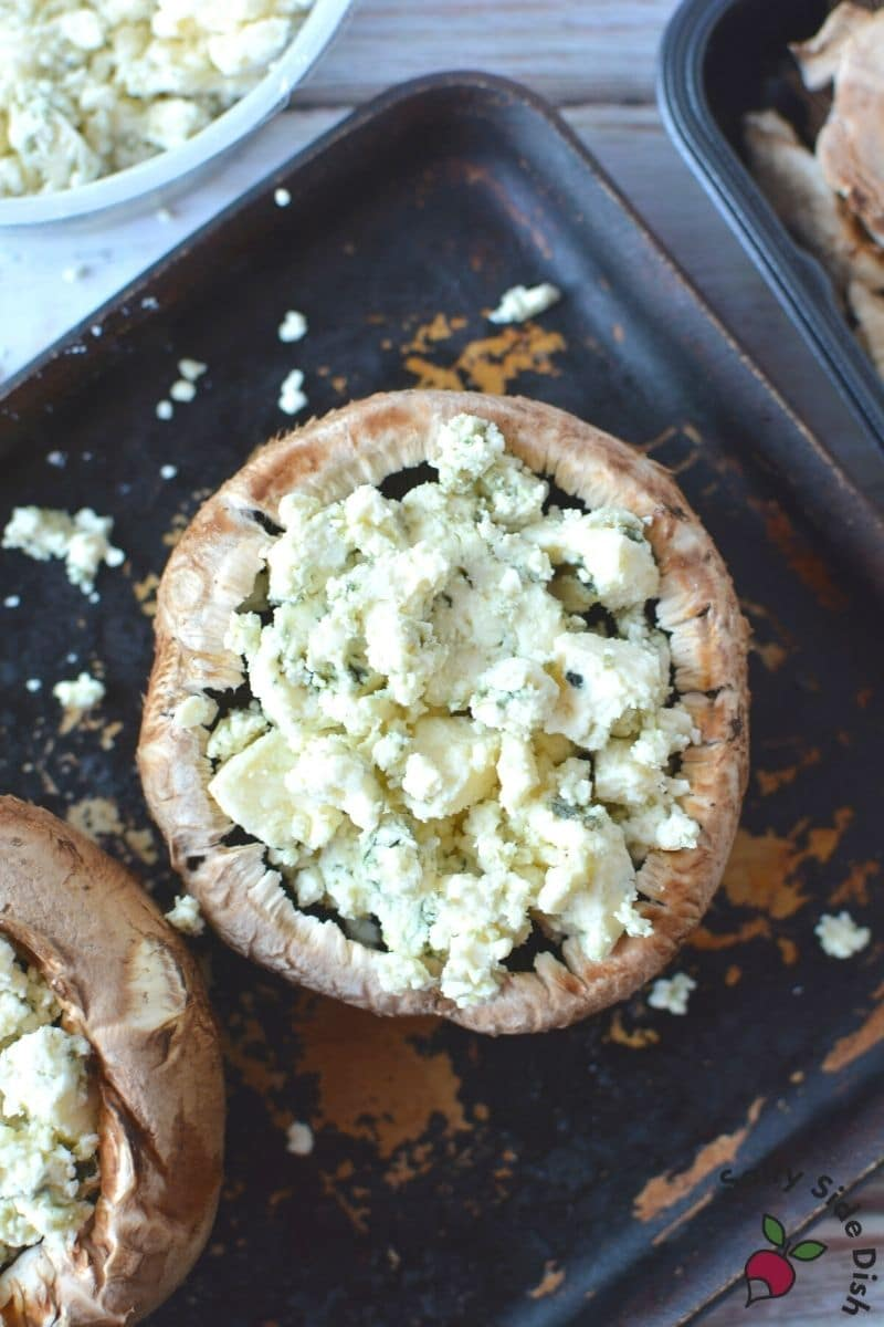Baking Stuffed Portobello Mushrooms with crumbled blue cheese