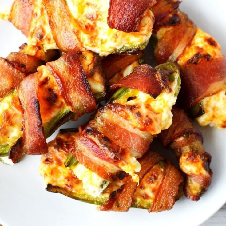 stuffed jalapenos with bacon on a white plate