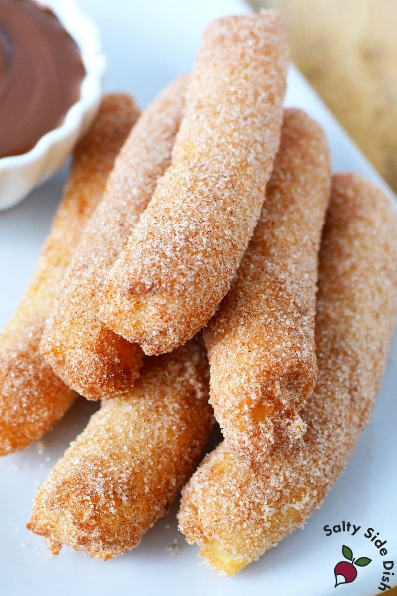 plate of churros with chocolate dipping sauce