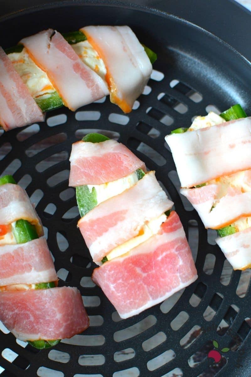 wrap jalapenos with half cut bacon