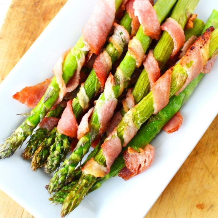 bacon wrapped asparagus in the air crisp basket of the ninja foodi