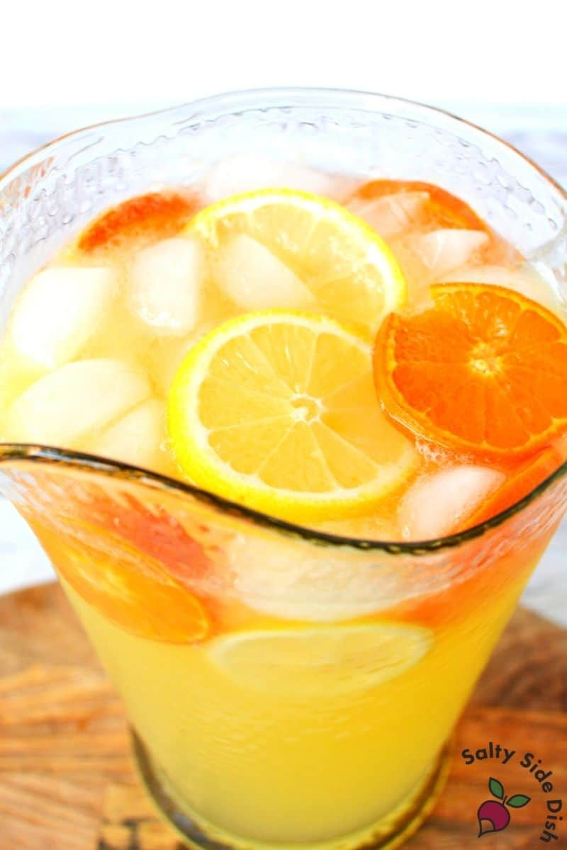 Sparkling Citrus Punch with slices of fruit and ice on top
