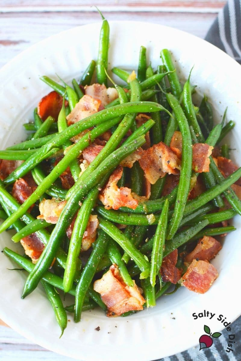 Ninja Foodi Green Beans and Bacon with seasoning piled up on a plate
