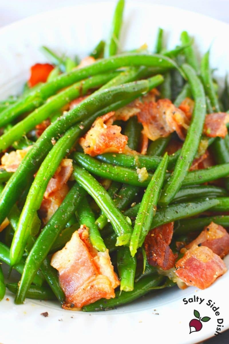 Ninja Foodi Green Beans and Bacon seasoned in a bowl and ready to eat