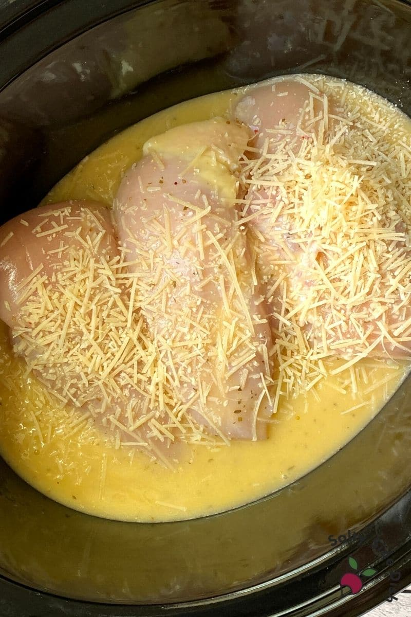Shredded Parmesan Cheese over slow cooker olive garden chicken