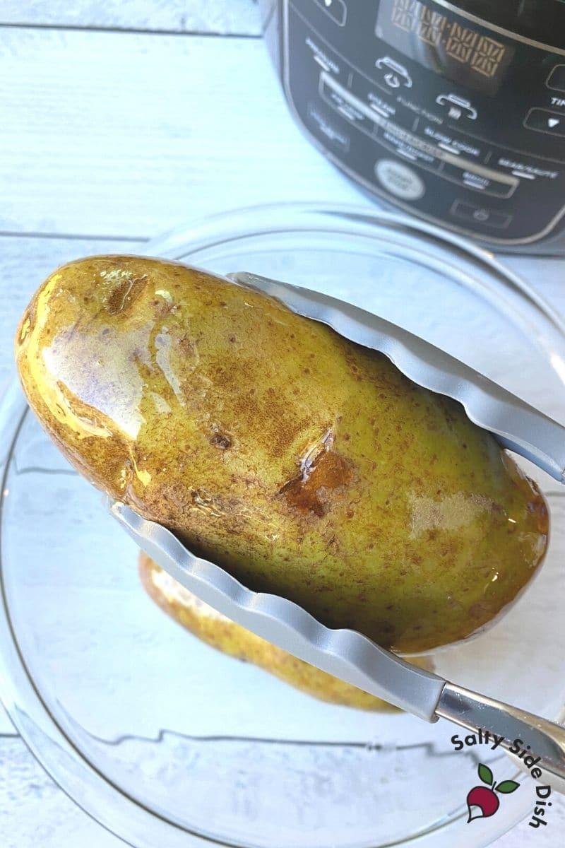 Baked Potatoes in Ninja Foodi are easy - for crispy skins add olive oil