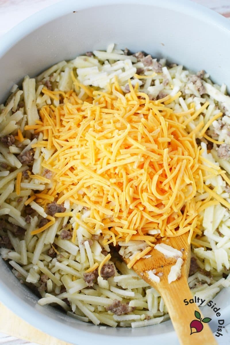 Add frozen hash browns to pot with the cooked sausage and mix well. Add cheese