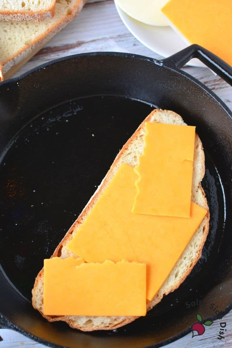 cheddar cheese slices laid on bread