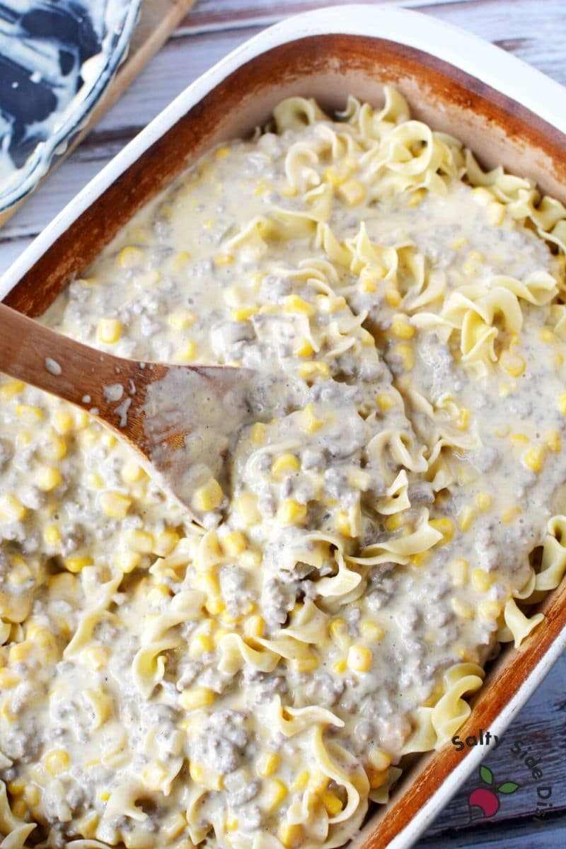 smother noodles with ground beef and corn plus velvetta mixture and mix well