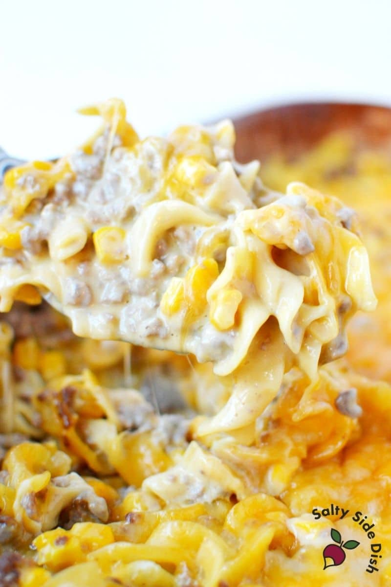 cheeseburger noodle casserole with a huge scoop on it ready to be served up as a main dish meal recipe in only 30 minutes