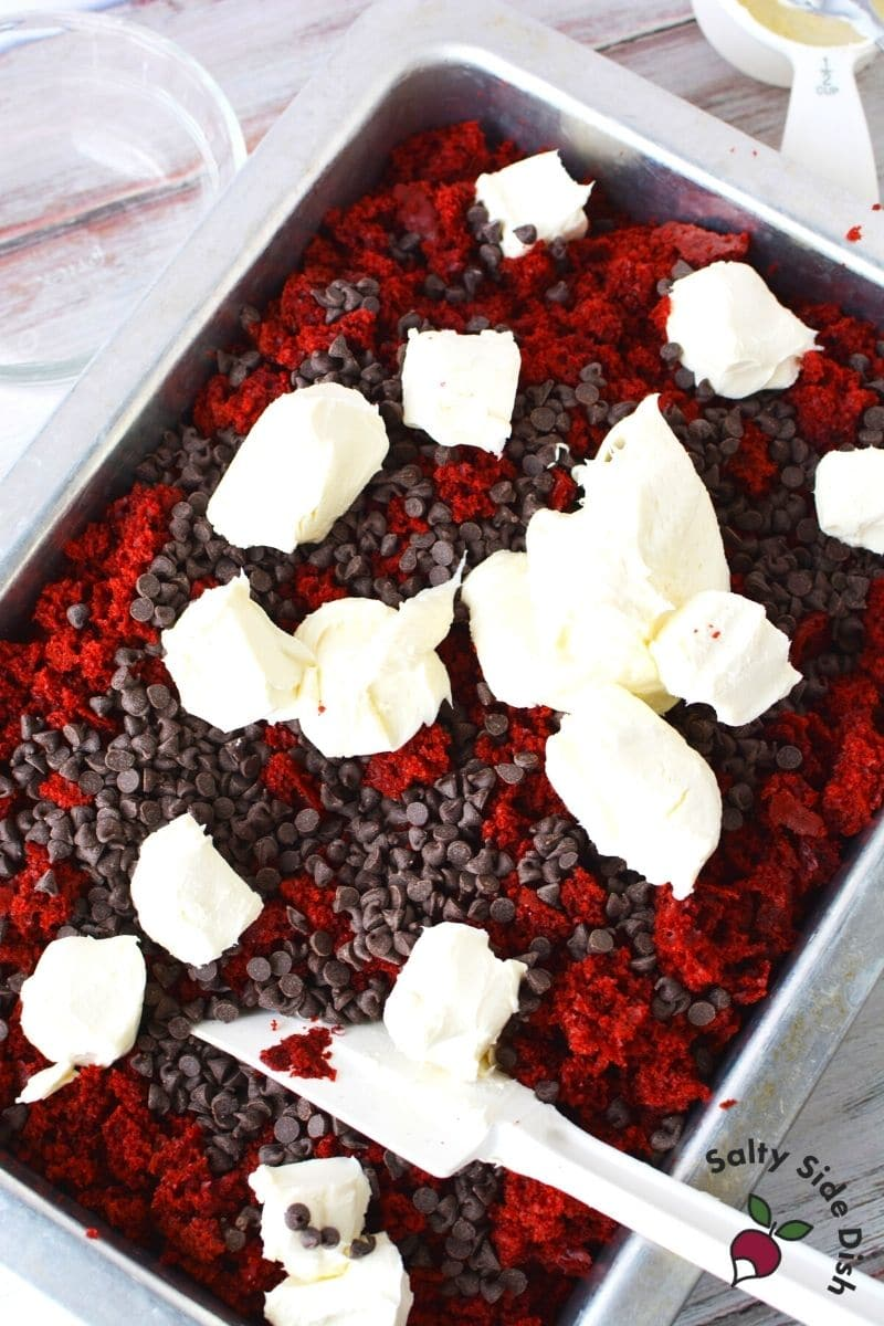 red velvet cake with chocolate chips and cream cheese being mixed up