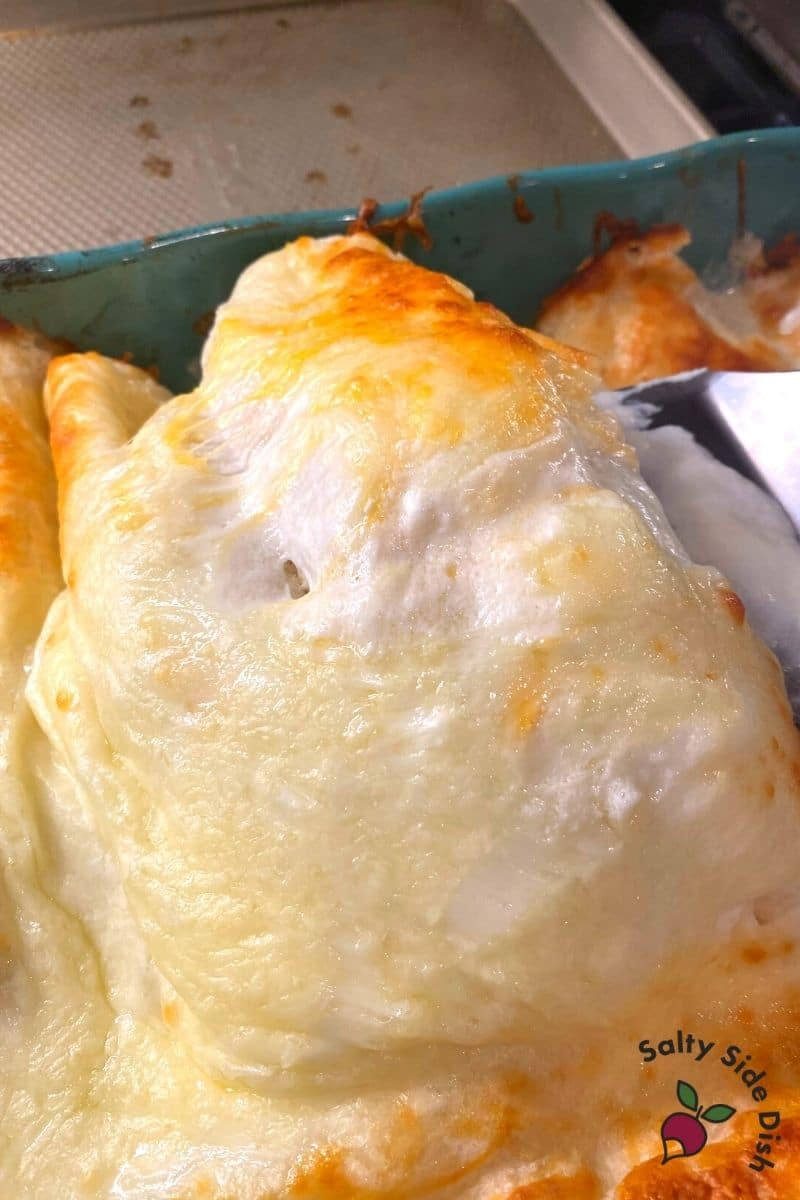 use a spatula to lift out chicken enchiladas