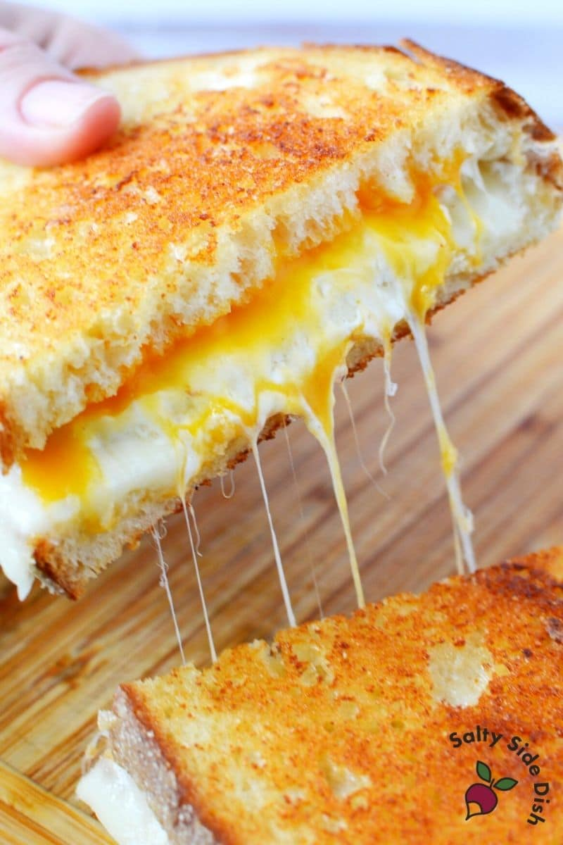 Super gooey cheese being pulled from the grilled cheese sandwich