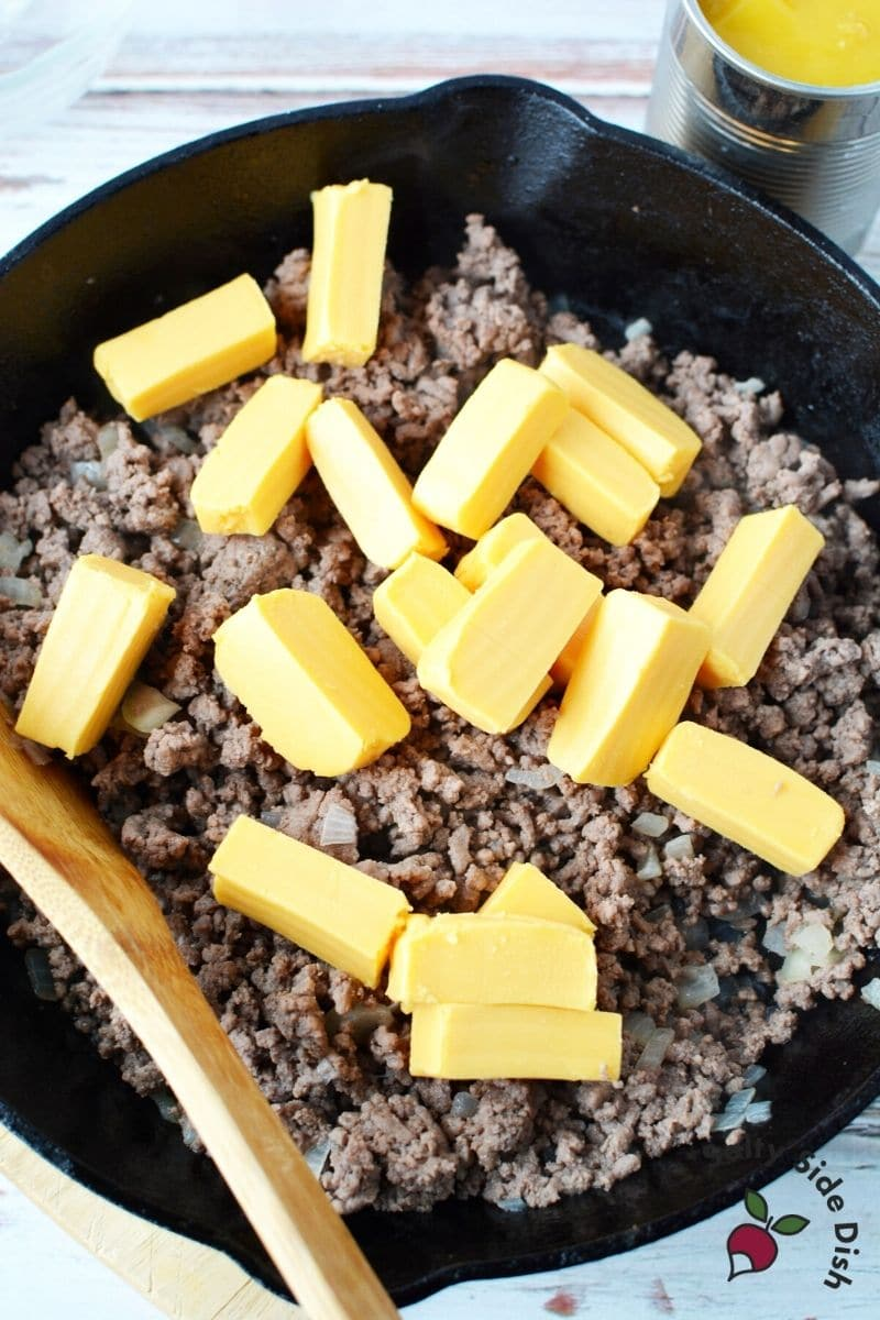 add slices or cubes of Velveeta cheese to hamburger