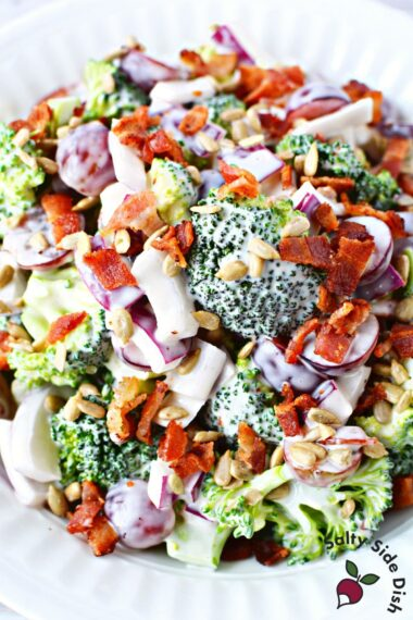 broccoli and grape salad in a white bowl.