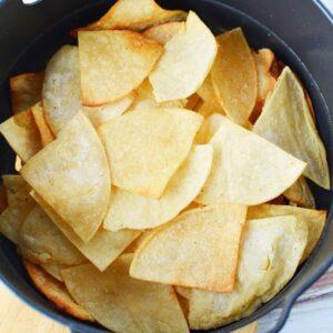 stacked up tortilla chips in air crisp basket