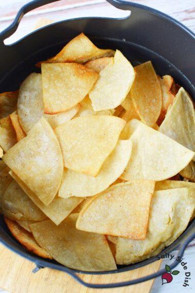 stack of tortilla chips in Ninja Foodi Air Crisp Basket